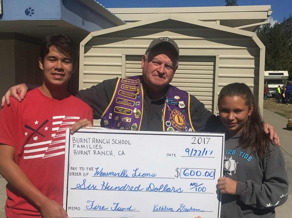 Burnt Ranch present a check to the Lions Club Fire Fund