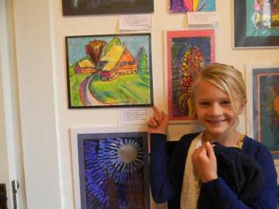 2019 Young Artist Showcase student near art
