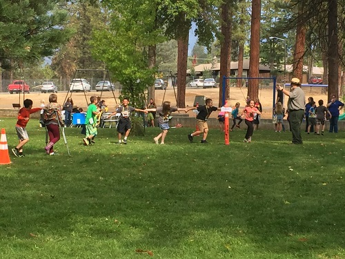 Students playing field games